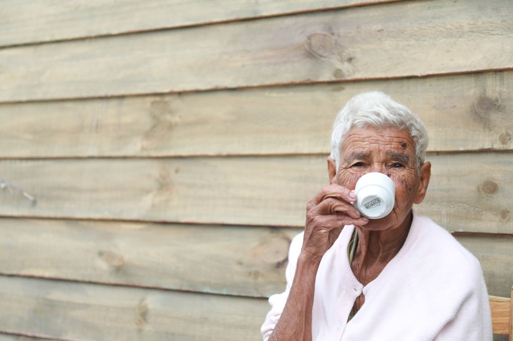 Coffee Could Keep Your Brain strong As You Age / Older Woman Drinking Coffee