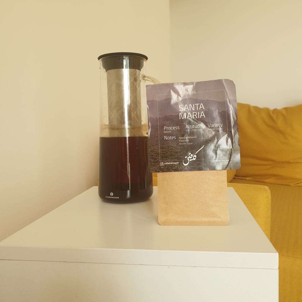 Cold brew coffee in a special jar filled with coffee with a coffee beans bag next to it, from Brazilian origin.