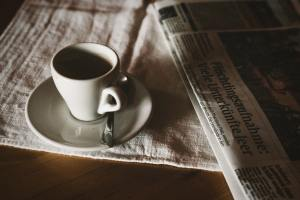 Blog Banner Image - Cup of espresso on a newspaper